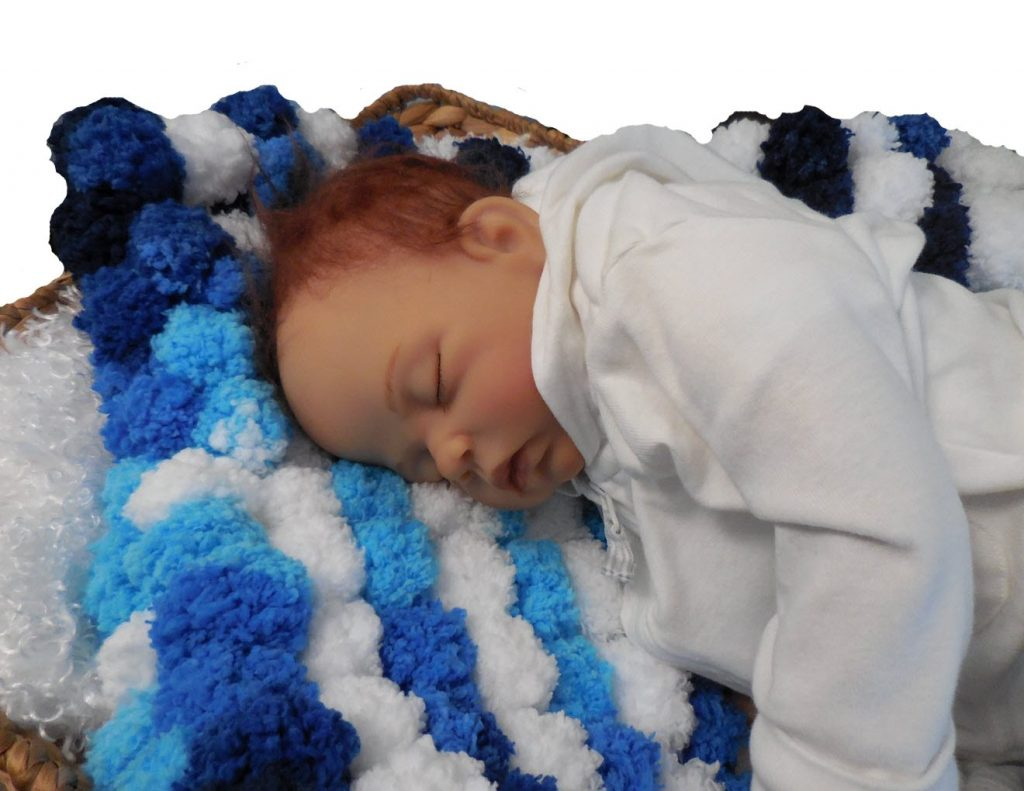 blues and white pompom photo prop